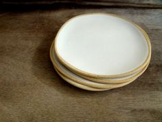 White Ceramic plates ,Set of 4 Handmade Stoneware Plates, Dessert plates,  Organic serving plates , Ceramic cake plate, wabi sabi pottery by bininaor on Etsy https://www.etsy.com/listing/229171940/white-ceramic-plates-set-of-4-handmade