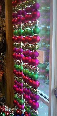 Window dressings for Christmas.  Lights hung alternately with strings of balls would look cool at night too.