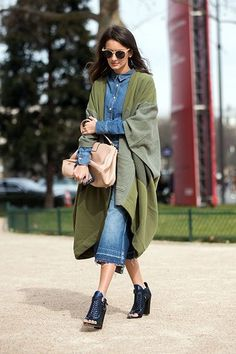Denim culottes, a denim shirt and black heeled boots matched with a green shawl, and cream bag | Image via refinery29.com