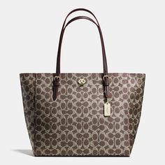 This effortless, go-anywhere tote has a graphic look in our signature fabric and ample room for essentials. Buckled strap anchors, a polished metal hangtag and a hidden pocket secured with a petite turnlock add a quintessential Coach finish to its hand-assembled design.