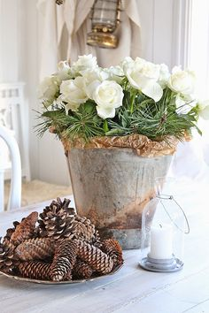 Combine flowers with evergreens and pine cones