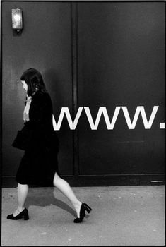 David Gibson: Spring loaded - (It looks as if the sign on the wall is a spring connected to the woman) David Gibson, Urbane Fotografie, Photography Store, Diane Arbus, Photo B, Contemporary Photography, Street Photographers, Black And White Photography, Old Photos