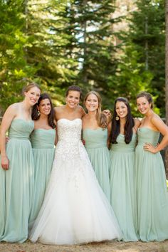 Gorgeous dress and beautiful mint bridesmaid dresses: http://www.stylemepretty.com/california-weddings/lake-tahoe-ca/2014/10/06/tuscan-inspired-lake-tahoe-wedding/ | Photography: Mike Larson - http://mikelarson.com/