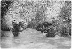 Dong Ha, Vietnam. Operation Hastings - Marines of Company H, 2nd Battalion, 4th Marine Regiment take to the water as they move to join up with other elements of their battalion. (July 1966)  (Picture courtesy of the National Archives and Records Administration.)