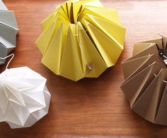 Snowpuppe chestnut yellow   Beautiful folded lamp of yellow paper. Completely manufactured in the Netherlands. With the lamp you receive a cord with socket. The diameter of the widest part is 25 cm, the height is 25 cm. Studio Snowpuppe      89.00EUR