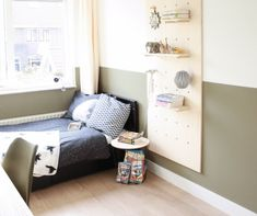 Boys room with olive green half painted wall, black bedding and cute pegboard storage system Green Boys Room, Bedroom Green, Little Boy Bedroom Ideas, Kids Bedroom, Olive Green Rooms, Half Painted Walls, Boy Room Paint, White Duvet, Teenage Room