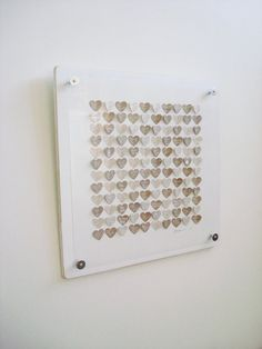 wedding guest book alternative. guests sign their names on small brown paper hearts then gets made into wall decor.