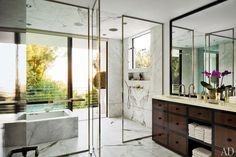 Designer Waldo Fernandez's Los Angeles master bath is sheathed in Calacatta marble; the tub is by Kohler.Pin it.