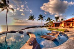 Enjoy an amazing view of the ocean in Hawaii at this oceanfront home featuring a pool.