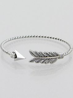 A twisted arrow cuff bracelet featuring an open cuff and detailed feathered designed with an adjustable fit. Great for stacking with other bracelets. Available