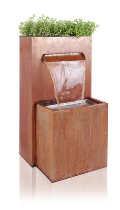 Corten Steel Waterfall Cascade Planter with LED Lights - H89cm x W40cm Specifications Height: 89cm (2ft 11in) x Width: 40cm (1ft 3¾in) x Depth: 41cm (1ft 4¾in)) Cable length: 10m (32ft 9¾in) Pump power: 50 watts Features Corten steel – forms a stable