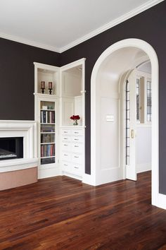 Love the woodwork and the arched pocket doors! Beautiful built ins!