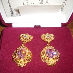 Jacqueline Kennedy Haute Couture Pierced Earrings. Jackie's taste for haute couture is evident in this stunning suite. In 1962, she set off for India with her sister on an unofficial state visit where she wore these pieces.