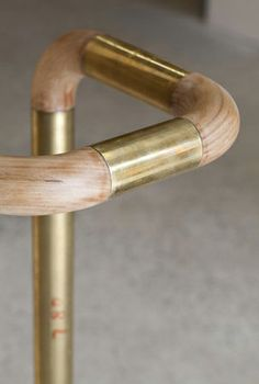 """Mim Design created this custom brass and wood """"Sleeve"""" handrail for the Australia based company Little Group. Photography by Peter Clarke."""