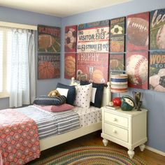 Gallery art wall in a sports themed boys bedroom.   What a great look !