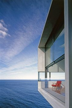 Incredible modern architecture.  House overhangs water.
