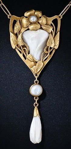 This thoroughly enchanting and consummate Art Nouveau necklace from the early 1900s features four bright shimmering natural freshwater pearls, the largest of which is embraced by an artfully sculpted foliate motif rendered in acid-finished yellow gold. The pendant portion of this sublime Art Nouveau jewel measures just a tad shy of 3 inches long by 1 1/4 inch wide. The original silver gilt chain measures 22 inches-plus. The back is engraved 'EJM June 7, 1910' Artist unknown.