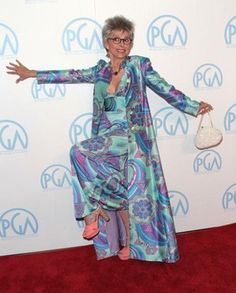 Rita Moreno through the years still holds her beauty and poise. (See more photos)