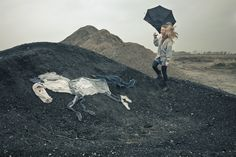 this photographic essay by photographer Ulrika Kestere is based on a fairy tale about a woman whose drying laundry is taken by a sudden storm, and as she travels the countryside discovers her clothing has taken an unexpected form.