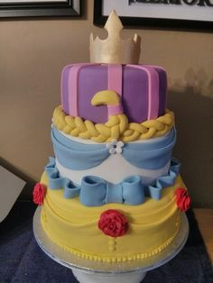 Bell, Cinderella, Rapunzal and Sleeping Beauty cake.