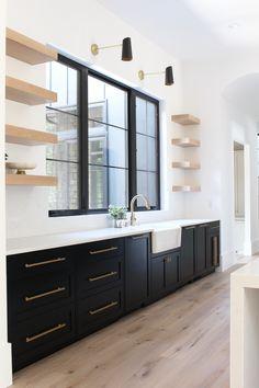 Love the sophisticated look of black kitchen cabinets with white oak floating shelves Best Kitchen Cabinet Paint, Black Kitchen Cabinets, Painting Kitchen Cabinets, Black Kitchens, Green Cabinets, Island Kitchen, Kitchen Cabinetry, Dream Kitchens, Kitchen Backsplash