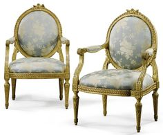 A pair of Italian carved giltwood armchairs, in the manner of Bartolomeo Manghetti, Turin, last quarter 18th Century.