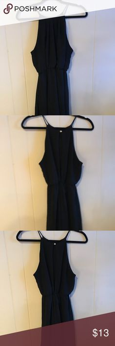 Versatile Little Black Dress Simple little black dress that can be dressed up or down. High neck. Flowing. Synched at waist. Windsor Dresses Mini