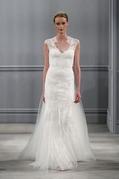 Harper gown by Monique Lhuillier for her Spring Summer 2014 bridal collection. Silk white illusion neckline lace appliqué sheath with open back together with a detachable tulle train.