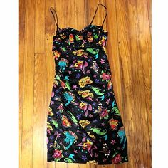 Betsey Johnson Super Rare Tattoo Pin Up Dress Extremely rare silk Betsey Johnson dress with colorful tattoo pop art pattern! The back has a really pretty keyhole cut out that you can tie in a bow, and the straps can be tucked in if you prefer to wear strapless! GREAT!! condition Betsey Johnson Dresses Midi