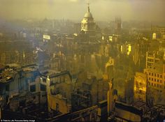 Standing tall: The spire of the Central Criminal Court - better known as the Old Bailey - rises defiantly while all around it buildings have become jagged shells in a landscape scarred by the relentless German bombings