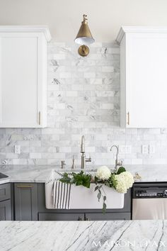Gray and White and Marble Kitchen Reveal - Maison de Pax - - Gray and white cabinets, marble subway tile, Carrara countertops, a farmhouse sink, and brass hardware give this marble kitchen a classic yet modern look. White Shaker Kitchen, White Marble Kitchen, Backsplash For White Cabinets, Gray And White Kitchen, Grey Countertops, Kitchen Cabinets, Marble Kitchen Ideas, Kitchen Backsplash White Cabinets, Modern White Kitchens