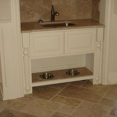 Beautiful built-in dog feeding station. Out of the way and with easy access to water!