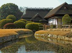 stream with stone embankment, in the Korakuen Garden, Okayama, Japan