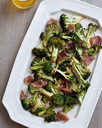 This quick, easy roasted broccoli recipe calls for slathering the raw vegetable in a tangy mustard sauce, then adding bacon once it's cooked.