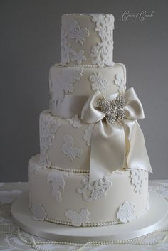 Lace applique wedding cake with bow detail