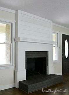 fireplace makeover @BeneathMyHeart.  See also her white washed brick wall in their bathroom.