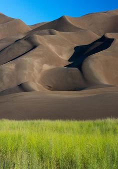 When traveling to Durango from Denver or Colorado Springs stop at the Great Sand Dunes National Park, Colorado.