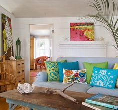 What a happy, colorful main living area! via House of Turquoise Living Room Pillows, Coastal Living Rooms, Home Living Room, Living Area, Small Living, Beach Cottage Style, Beach Cottage Decor, Coastal Decor, Coastal Style