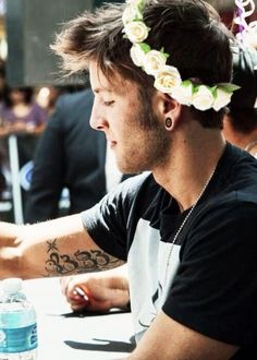 "drew chadwick; emblem3. dear all haters he is not ""gay"" cause he has flowers in his hair a fan gave them to him"