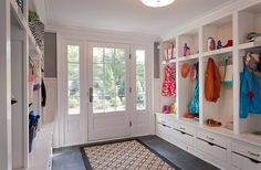 Many times, a welcome mat or floor rug isn't enough to the keep the muddy shoes and snowy boot tracks in check. For this reason, we recommend a no-slip tile or slate floors for high traffic entryways in lieu of hardwood floors. From Our Blog at Design Connection, Inc. | Kansas City Interior Design http://www.designconnectioninc.com/the-dirt-stops-here-creating-your-ideal-mud-room/ #InteriorDesign