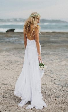Stunning low back white lace wedding dress, dreamy floaty skirt and short lace front hem on