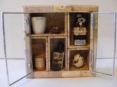 Shadow box - love the aged paper it's covered in. This would be perfect for showcasing some of the small antique family treasures...