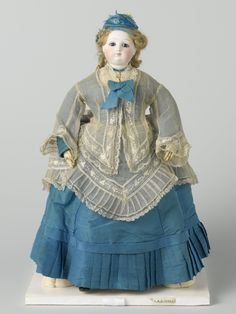 Doll with blonde hair and a silk blue dress and hat, 1875
