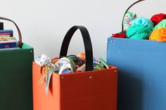 Belted Storage Totes   Brit + Co. These would fit perfectly in the little man's room...colors and all!!! @Brit Morin Morin #totes