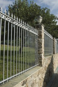 Short stone wall with wrought iron similar to this - not as tall.