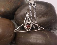 Sterling silver and garnet celtic knot pendant £32.00