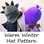 Free pattern for winter hat with dinosaur spikes or pom-pom. Pattern drawn for 2-3T but easily adjustable.