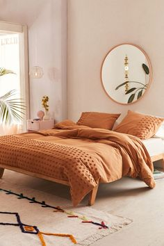 Urban Outfitters Tufted Dot Duvet Cover in orange for about $100.