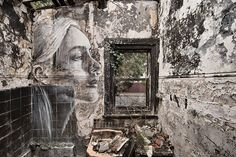 rone's murals of beautiful women haunt wrecked buildings + abandoned homes