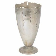 "Add an artful touch to your entryway console table or living room mantel with this eye-catching vase, showcasing a silver finish and organic cutouts.  Product: VaseConstruction Material: BrassColor: SilverFeatures: Cutout designDimensions: 10.25"" H x 5.25"" Diameter"